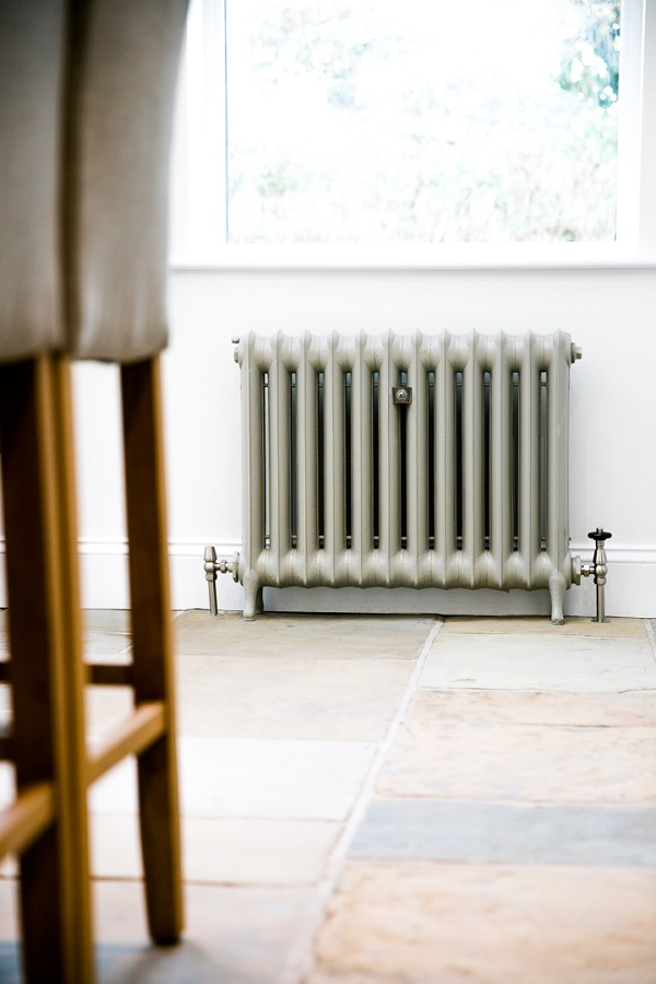 Duchess cast iron radiator painted in Little greene paint companies Serpentine against slaked lime