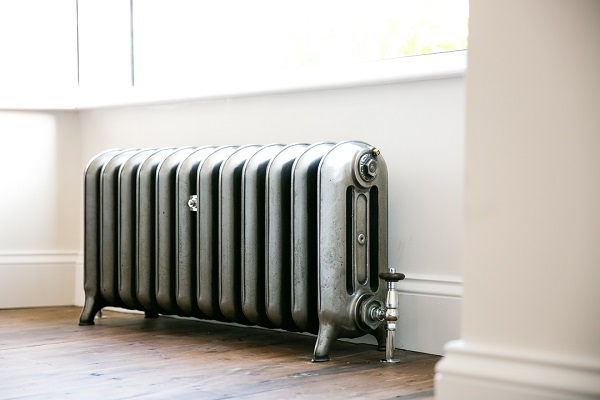 Low warehouse cast iron radiator in a hand burnished finish