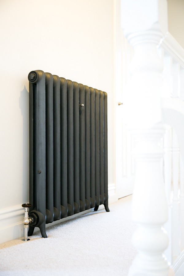 Tall duchess cast iron radiator finished in pewter sparkle against little greene paint companies french grey