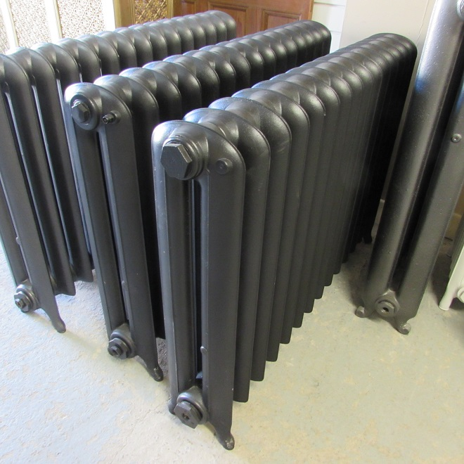 Pair of black cast iron radiators
