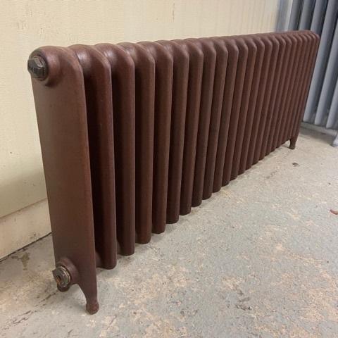 Reclaimed school radiator in rust finish