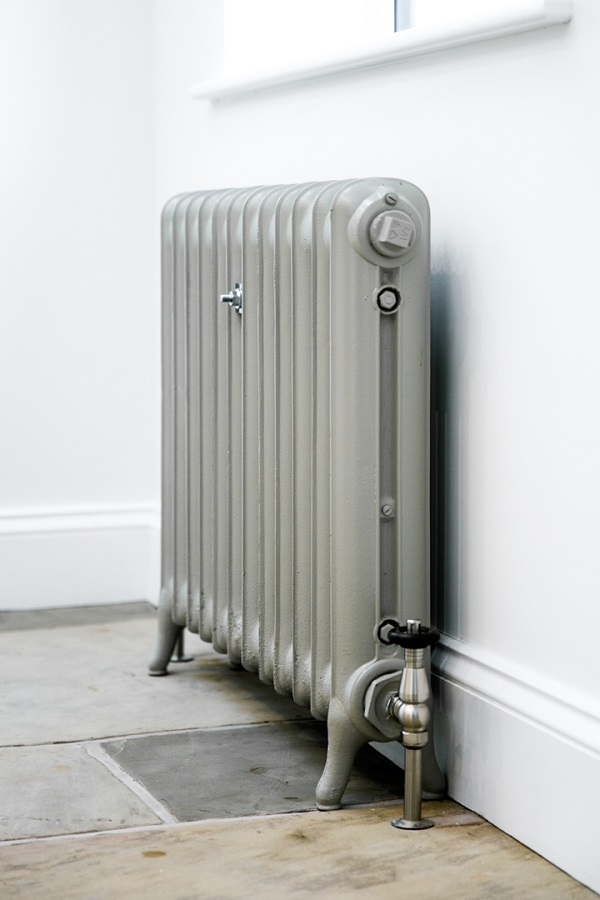 Duchess cast iron radiator painted in Little Greene Paint companies Serpentine